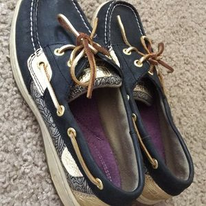 Navy and gold Sperry shoes